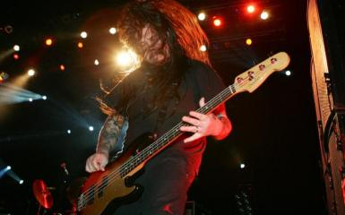 Deftones Bassist Chi Cheng, pictured here from a '06 concert, continues to defy the long odds in his slow but steady recovery from a 2008 car accident. (Photo: Ethan Miller / Getty Images)