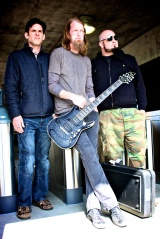Adema is (L-R)  Kris Kohls (drums), Tim Fluckey (vocals, guitars) and Dave DeRoo (bass, backing vocals).